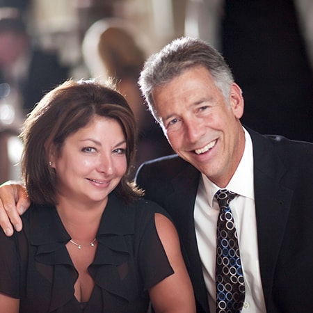 One of our dentists in Bloomfield Hills, MI, smiling with his wife