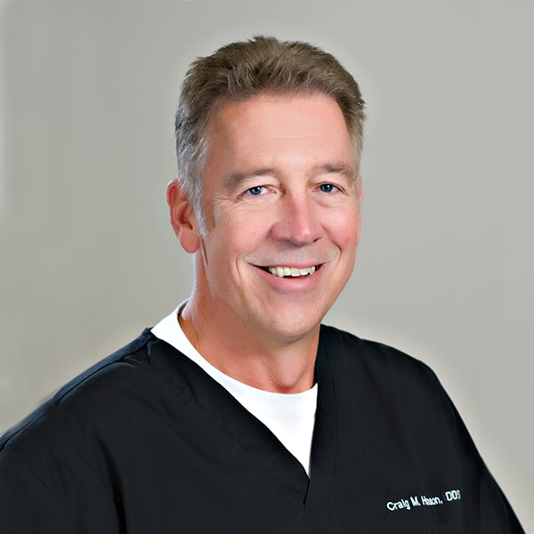 Dr. Hanson smiling while wearing his dentist uniform