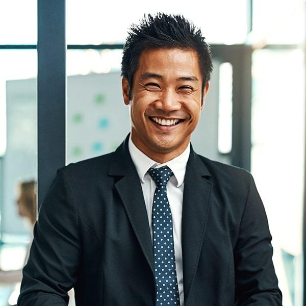 Man in suit smiling.